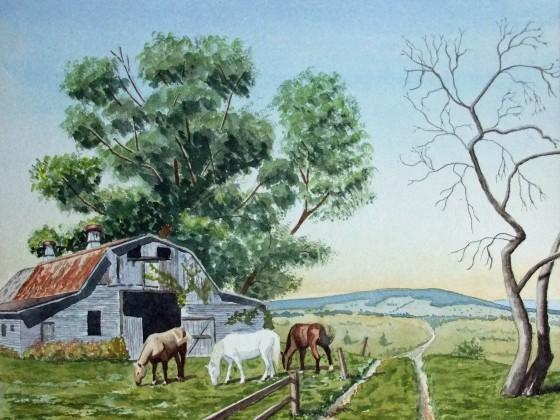 Pferde vor einer Scheune